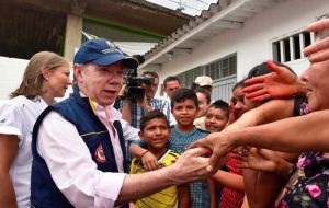 Colombian President Juan Manuel Santos flew to Mocoa, population 345,000, to oversee rescue efforts on the city outskirts and speak with affected families.