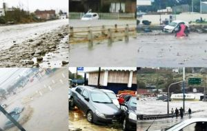 Mud and water covers cars and floods shops in downtown Comodoro Rivadavia