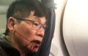 The 69-year-old physician had refused to leave, saying he needed to go home to see his patients. He was then dragged down the aisle of the aircraft.