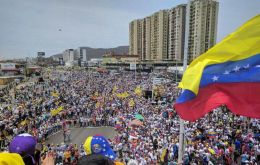 "Thousands of people waving Venezuelan flags and shouting ""No more dictatorship"" took to the streets in the capital and across the oil-rich nation."