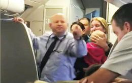 According to the video posted the flight attendant forcefully took the stroller from the woman, hitting her with it and just missing her child.