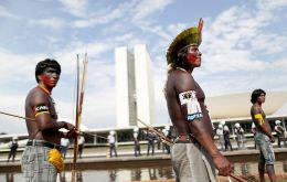 Demonstrators carried coffins representing indigenous dead in the takeover of their ancestral lands across Brazil and some tried to break into the Congress building.