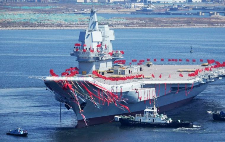 "Analysts said the ship represented a ""status symbol"" for Beijing in a contested region but posed little threat to advanced US carriers."