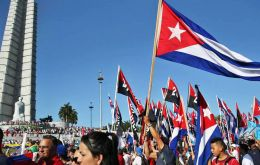 May 1 rally brings hundreds of thousands of Cubans to Havana's Revolution Square in a sea of red, white and blue flags and portraits of Fidel Castro.