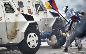 In a second incident an anti riots armored vehicle runs over some protestors who were throwing stones and sticks