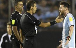 Superstar Lionel Messi discussing with the referees and assistants