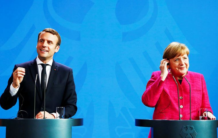 Macron and Merkel said they would work together more closely on defense, Euro zone reform and reducing bureaucracy.