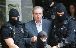 "Cunha is in prison after found guilty of taking millions in bribes from  Petrobras. According to the account, Temer told Batista: ""You need to keep doing that."""