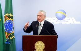 """At no time did I authorize the paying of anyone,"" Temer said emphatically, raising his voice and pounding his index finger against the podium."