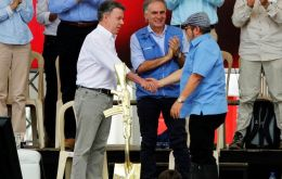 FARC rebel leader Rodrigo Londono, also known as Timochenko, Colombian President Juan Manuel Santos and Jean Arnault, the UN Secretary-General's Special Representative for Colombia and Head of the UN