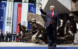 Trump spoke before a cheering, flag-waving crowd of 10,000 people at historic Krasinski Square in central Warsaw