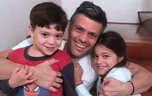 Leopoldo Lopez joins his children at home in a photo released by his family