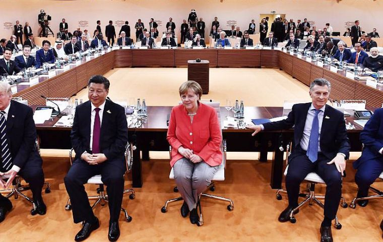 """In the end, the negotiations on climate reflect dissent – all against the United States of America,"" Merkel told reporters at the end of the meeting"