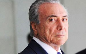 Temer rubber-stamped the act as he tries to gather support in Congress, which is deciding whether to authorize the Supreme Court to try him for corruption