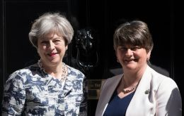Britain's Prime Minister, Theresa May, left, greets Arlene Foster, the leader of Northern Ireland's Democratic Unionist Party at Downing Street