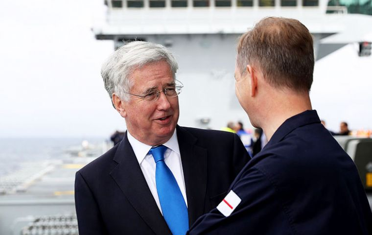 Sir Michael Fallon with officers from HMS Queen Elizabeth