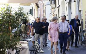 Mrs. May and her husband Philip photographed enjoying their holiday in Desenzano del Garda