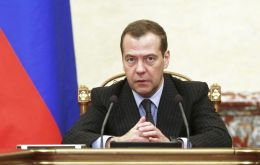 "Russian Prime Minister Dmitry Medvedev called the sanctions tantamount to a ""full-scale trade war"""
