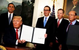 Trump returned to Washington to sign the order authorizing Trade Representative Robert Lighthizer to explore whether to undertake a Section 301 investigation.(Pic Reuters)
