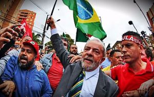 Supporters of Lula, many wearing the trademark red of his Workers' Party, gave him a rock star's welcome as he made his way through the crowd to enter the court
