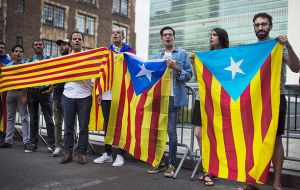 "Many demonstrators wrapped themselves in the ""estelada"" flag, which has become a symbol of those in favor of an independent Catalan republic"
