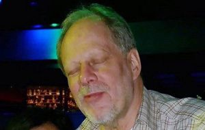 A gunman, named as 64-year-old Nevada resident Stephen Paddock, opened fire from the 32nd floor of the Mandalay Bay Hotel towards an open-air music festival .