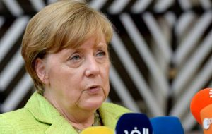 But Mrs. Merkel held out the prospect the leaders of the remaining 27 EU states may be ready to kick off trade talks at their next scheduled summit