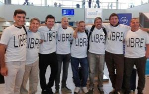 "The group posed for a photo minutes before boarding their flight according to La Nacion. All of them were sporting ""Libre"" shirts, the Spanish word for free."