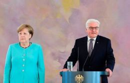 Angela Merkel and President Frank-Walter Steinmeier are attending several ceremonies in Wittenberg