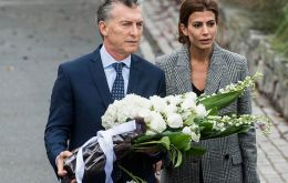 """Unfortunately, five families were destroyed"" in this ""cowardly attack,"" Macri said, laying a wreath of white flowers at the site alongside his wife."