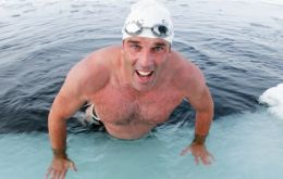 British endurance swimmer Lewis Pugh completed a 1km swim in the freezing waters of UK Overseas Territory South Georgia and the South Sandwich Islands