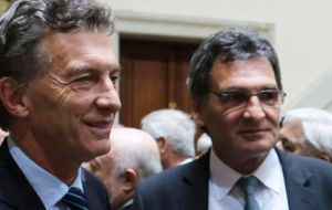 The order was signed by President Mauricio Macri and presented by Argentina's Human Rights Secretary Claudio Avruj (L)