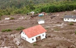 Aerial video of the devastation showed debris and portions of the village half-buried beneath the mud in the valley