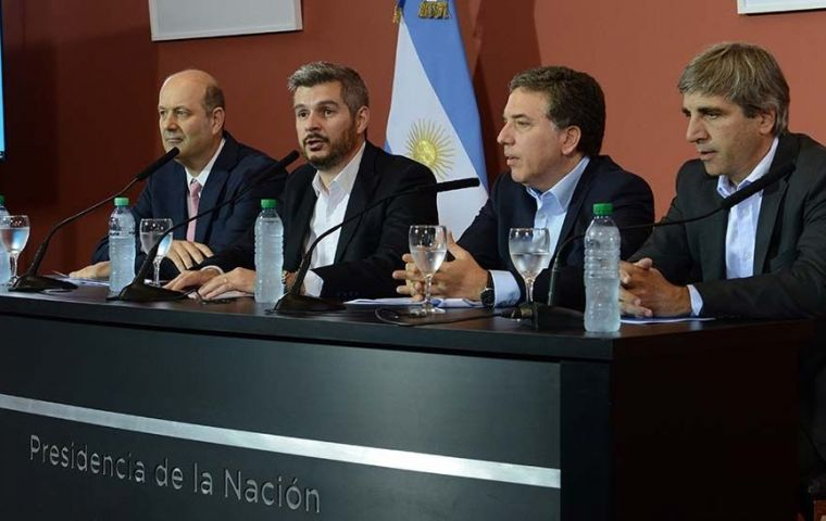 Cabinet Chief Marcos Pena, Treasury Minister Nicolas Dujovne and Central Bank Governor Federico Sturzenegger at the news conference at the Casa Rosada