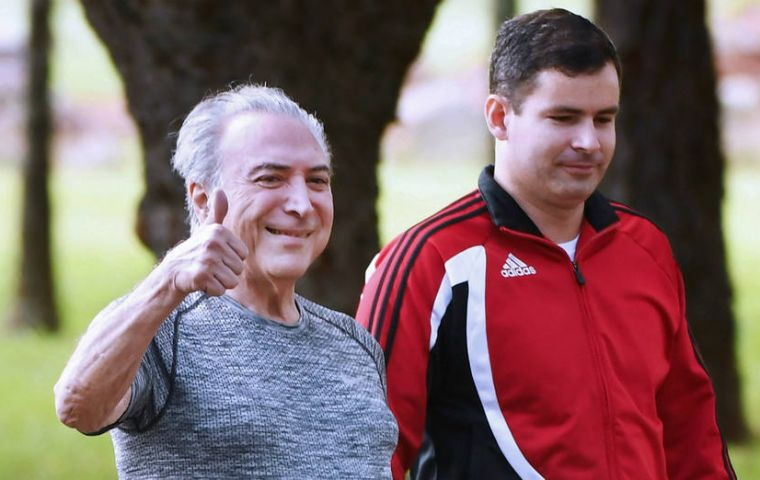 "Dressed in jogging gear and flanked by bodyguards, a grinning Temer gave the ""thumbs-up"" sign and declared he had ""fully recovered"""