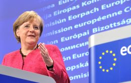 """We have felt since the elections that the world will not wait for us, and in particular...we are convinced we need a new call for Europe,"" Merkel said"