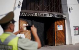 The attackers set fire to at least two of the churches in Santiago and tossed pamphlets in the street.