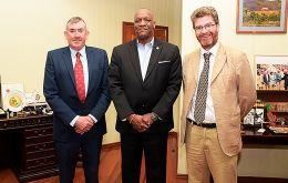 MLA Hansen, left, with Minister of State Joseph Harmon, center, and British High Commissioner to Guyana, Mr. Gregory Quinn.