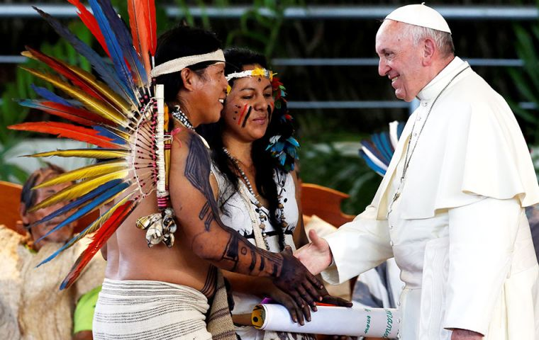 Bare-chested and tattooed native families, many sporting feathered and beaded headgear, interrupted Francis with applause, wailing horns and beating drums