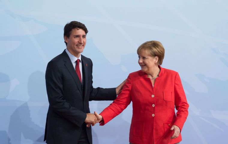 Canada's Prime Minister Justin Trudeau and Germany's Chancellor Angela Merkel are viewed as the most respected globally,