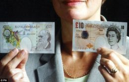The new UK £10 note is easily distinguishable as Jane Austen is now replacing Charles Darwin on the back.