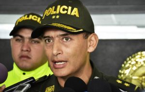 Barranquilla police commander Mariano Botero said the bomb detonated when officers gathered for morning formation; 49 officers were at the site