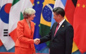 "Meeting in Beijing Xi told May the two countries should ""add new meaning into the bilateral ties so as to forge an enhanced version of the 'Golden Era"""