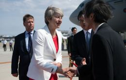 "Mrs. May told the business leaders that Brexit would allow UK to strike a free trade deal with Japan, and the industrial strategy made the UK ""more attractive""."