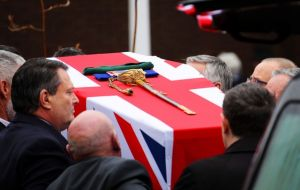 "Capt Jolly's coffin was dressed with the Union Jack, his medals, a sword and green beret. Comrade, Capt Erich Bootland, described him as ""larger than life"".(Pic RN/Mod/PA)"