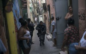 Army patrols were already used in Rio's gang-ruled favelas, but a decree signed on Friday by Temer now gives the military overall control of security operations in Rio