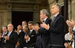 """They ask us for a shock adjustment, and to them I say we came here to reduce poverty and make sure that no Argentine goes hungry,"" Macri told a full house"