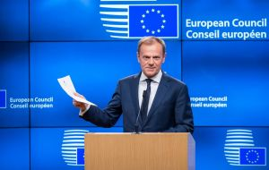 "Tusk offered a robust defense of the draft, which the EU says is a ""backstop"" for avoiding a ""hard border"" that might disrupt peace in Ireland"