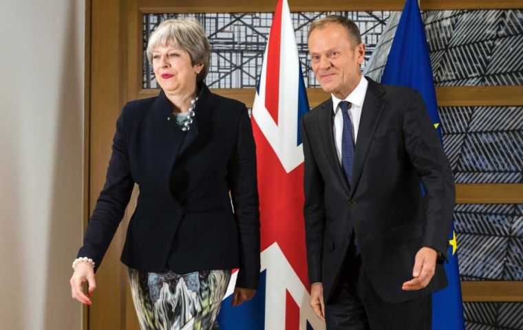 "May told Tusk a draft Brexit treaty published by EU was ""unacceptable"" in its proposal of keeping Northern Ireland effectively in an EU customs union"