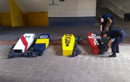"The four ""coffins"" discovered by the police in Rosario, with the yellow one dedicated to president Macri"